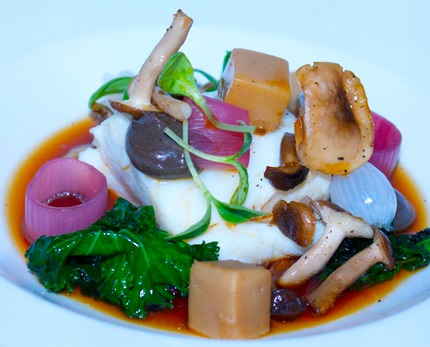 -Baked cod served with a jerusalem artichoke, sautéed green cabbage, white pickle pearl onion, and red pickle shallots rings, pan-fry Bøgehatte, brown mushrooms & morel consommé, pluck borage cress.